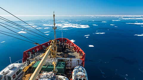 Blue skies and calm waters greet the team searching for the H.M.S Terror. The CCGS Sir Wilfrid Laurier sets out on its journey, carrying Parks Canada's RV Investigator and the Canadian Hydrographic Service's two launches, Gannet and Kinglett.