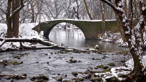 Snow covers a stone-arch bridge on Lititz Run, circa 1890, by the Pinetown bridge near the village of Oregon, Pa. in Lancaster County on Saturday, Jan. 24, 2015. (AP Photo/LNP Media Group, Dan Marschka)