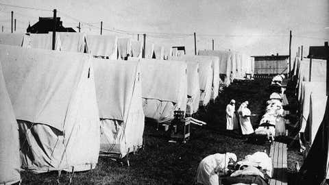 Nurses care for victims of a Spanish influenza epidemic in tents during an outdoor fresh air cure, Lawrence, Mass., ca. 1918. (Hulton Archive/Getty Images)