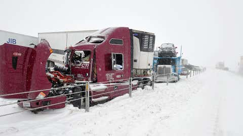 Officials work to document the accident and clear wreckage at the scene after a major pileup involving more than 2 dozen vehicles closed Interstate 40 eastbound traffic near Hope Road, 10 miles west of Amarillo, Texas, Monday, Feb. 23, 2015. (AP Photo/Amarillo Globe-News, Michael Schumacher)