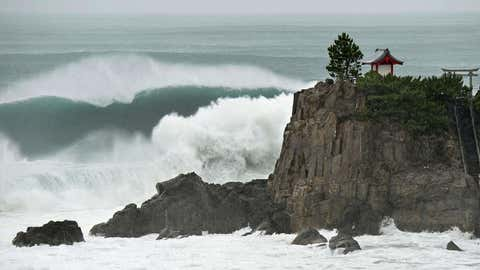 In this July 16, 2015 photo, waves crash against Katsurahama in Kochi on the island of Shikoku, western Japan, as a strong tropical storm sweeps across western Japan. (Kyodo News via AP)