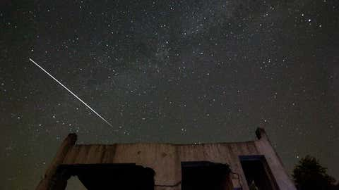 Stars and meteor streaks are seen behind a destroyed house, near Tuzla, Bosnia, Wednesday, Aug. 12, 2015. The annual Perseid meteor shower reaches its peak on Wednesday night. (AP Photo/Amel Emric)
