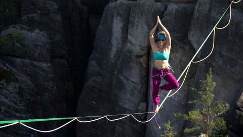 Daredevil Laetitia Gonnon pulls a yoga pose on a sackline in Ostrov, Czech Republic.