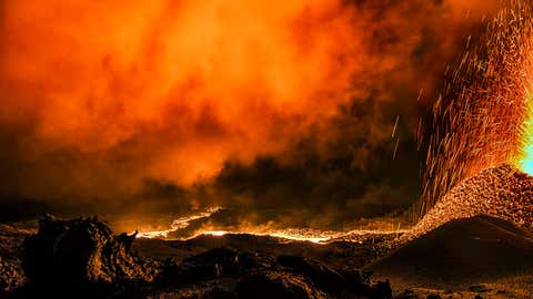 These stunning images show the red-hot lava shooting straight out of the volcano in super high definition, sending sparks flying and lighting up the sky with a red glow. The photos were taken at the Piton de la Fournaise volcano on Reunion Island, a French island in the Indian Ocean. (Luc Perrot/Caters News Agency)