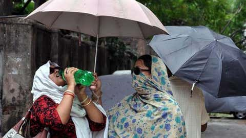 Women in India try to keep cool during a stifling heat wave in May 2015.