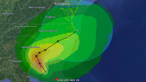 The cone of uncertainty, in blue, underlaid by the chances that winds of greater than 40 mph will impact a given area with increasing chances as the colors turn from green to orange.