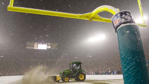 A snow plow drives down the endzone during the fourth quarter of the game between the Green Bay Packers and the Seattle Seahawks during the NFC divisional playoff game on January 12, 2008 at Lambeau Field in Green Bay, Wisconsin.  (Jamie Squire/Getty Images)