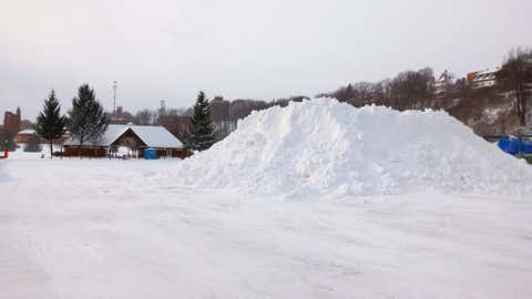 Snow piles mount in Marquette, Mich., on Jan. 31, 2013, after Winter Storm Magnus moved through the region. (iWitness Weather/Ray Troumbly)