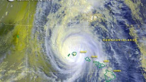 Satellite image of Hurricane Iniki making landfall over the island Kauai on September 11, 1992 at 1:58 p.m. HST.  (Credit:  NOAA)