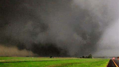 A tornado moves north in Canadian County after having just crossed SH-3, the Northwest Expressway, towards Piedmont, Okla. on May 24, 2011. (AP Photo/The Oklahoman, Paul Southerland)