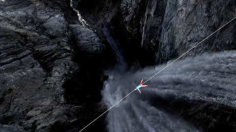 Lukas Irmler lays down on a line across Hunlen Falls in British Columbia, Canada.