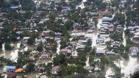 An aerial view shows floodwaters inundating houses and vegetation in Kalay, upper Myanmar's Sagaing region, on Aug. 3, 2015. (Ye Aung Thu/AFP/Getty Images)