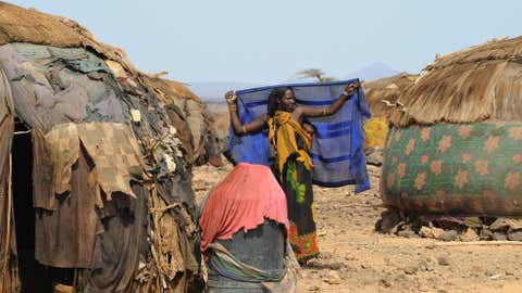 A Gabra woman stands outside her house in the village of Yaa-Sharbana on June 29, 2008 in North Horr, some 730 kms northeast of Nairobi. (SIMON MAINA/AFP/Getty Images)