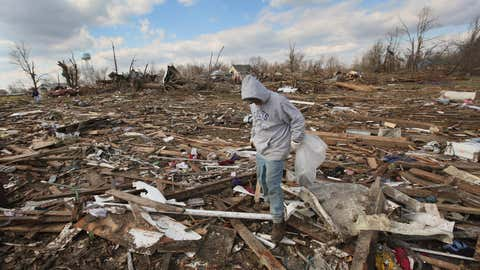 Tony Sherrard searches through debris that used to be his home for family keepsakes, March 3, 2012 in Marysville, Indiana. (Scott Olson/Getty Images)