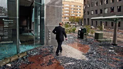 In downtown Houston, a man walks among the debris from Hurricane Ike on Sept.12, 2008. (Daniel Kramer/Houston Press)