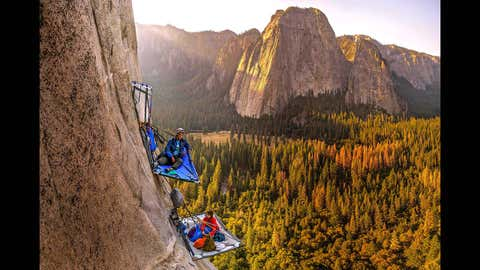 Morgane Choquet and Samuel Cobb relax in a vertical campsite on the slopes of El Capitan, Yosemite National Park.