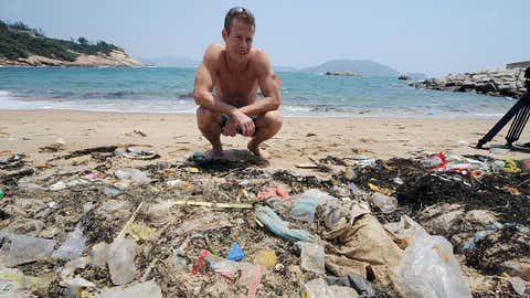 Doug Woodring, an entrepreneur and conservationist who lives in Hong Kong, displays rubbish on May 07, 2009 on a beach on the south side of Hong Kong which has been left uncleaned. (MIKE CLARKE/AFP/Getty Images)