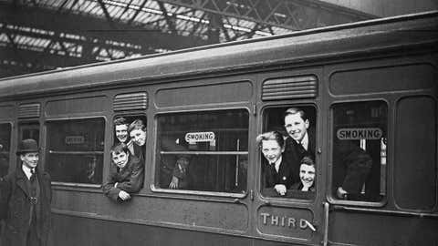 A group of orphaned boys from the Dr. Barnardo's Homes leave Waterloo Station in London for a new life in Canada, April 1923. (Topical Press Agency/Hulton Archive/Getty Images)