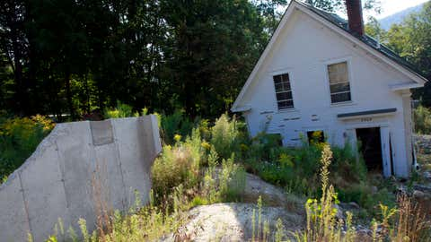 In this Aug. 22, 2013 photo, an abandoned home still lies askew in Pittsfield, Vt. (AP Photo/Toby Talbot)