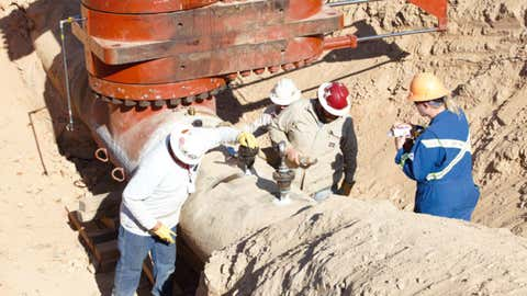 The photo above shows response personnel preparing for the evacuation of residual product in the pipeline segment.