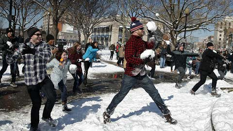 Participants take part in a snowball fight with over one hundred people in Dupont Circle Feb. 17, 2015 in Washington, D.C. The Washington D.C. area received 4-6 inches of snow overnight as a winter storm hit large areas of the east coast.  (Win McNamee/Getty Images)