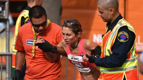 ASICS Elite Athlete Sara Hall is assisted by first aid after finishing the 2015 ASICS LA Marathon on March 15, 2015 in Los Angeles, California. (Jonathan Moore/Getty Images)