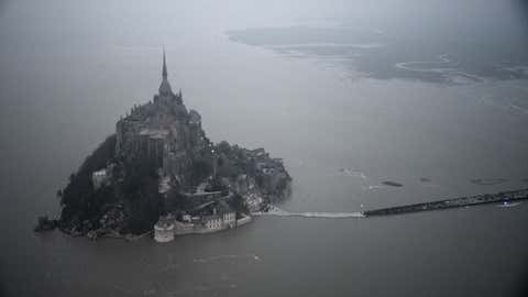 An aerial view shows the Mont-Saint-Michel surrounded by the sea during high tide on March 20, 2015. (DAMIEN MEYER/AFP/Getty Images)