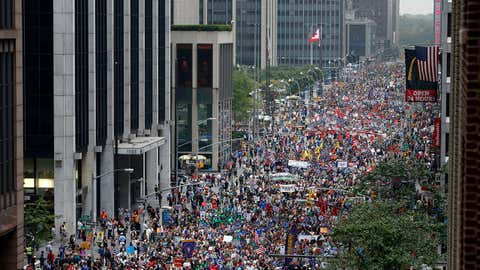 Demonstrators make their way down Sixth Avenue during the People's Climate March Sunday, Sept. 21, 2014 in New York. The march, along with similar gatherings scheduled in other cities worldwide, happened two days before the United Nations Climate Summit and a day before the start of Climate Week NYC. (AP Photo/Jason DeCrow)