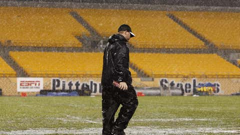 Workers try and prepare the field during a lightling delay prior to a game between the Miami Dolphins and Pittsburgh Steelers on Nov. 26, 2007, at Heinz Field in Pittsburgh. (Gregory Shamus/Getty Images)