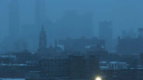 Buildings in the Brooklyn borough are obscured during a morning snowstorm on December 17, 2013 in New York City. (Spencer Platt/Getty Images)