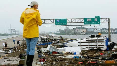 A man inspects a debris field on Route 45 left by Hurricane Ike on Sept. 13, 2008, in Galveston, Texas. (Mark Wilson/Getty Images)