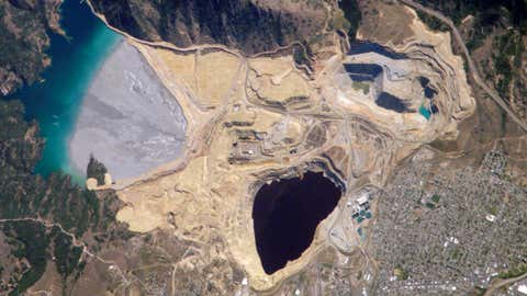Berkeley Pit and Yankee Doodle tailings pond: Butte, Montana. (NASA)