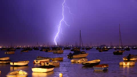 Lightning strikes over Poole Harbour during a thunderstorm on July 21, 2013, in Poole, England. (Dan Kitwood/Getty Images)