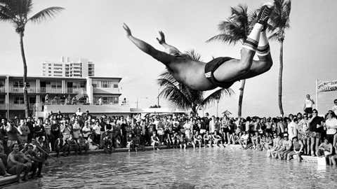 Wes Walton of Lehigh University competes in the belly flop competition at The Candy Store. Walton won the contest, March 10, 1984 in Fort Lauderdale, Fla. (Bob Mack/SF Sun Sentinel/Polaris)