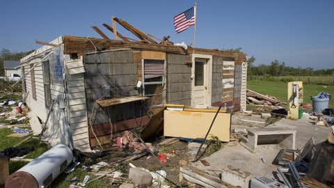 The home of Jack and Connie Payton sits abandoned after it was severely damaged by Hurricane Humberto September 14, 2007 in High Island, Texas. After the house was deemed a total loss, the couple moved in with relatives while they wait to rebuild their home. (Photo by Dave Einsel/Getty Images)
