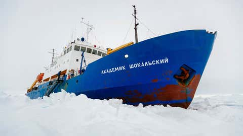 The Russian ship MV Akademik Shokalskiy is trapped in thick Antarctic ice 1,500 nautical miles south of Hobart, Australia, Friday, Dec. 27, 2013. (AP Photo/Australasian Antarctic Expedition/Footloose Fotography, Andrew Peacock)