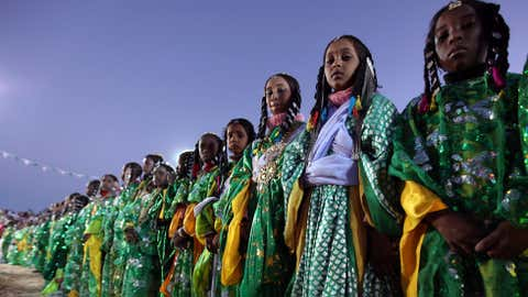 Girls from a nomadic Tuareg tribe dressed in traditional clothes attend the 16th International Ghat Festival, in the ancient city of Ghat in the heart of the southwestern Libyan desert on February 15, 2010. (MAHMUD TURKIA/AFP/Getty Images)