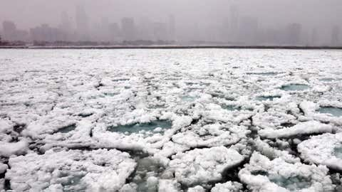 The Chicago skyline and a freezing Lake Michigan are seen from the Museum Campus in Chicago on Sunday, Jan. 5, 2014.  (AP Photo/Nam Y. Huh)