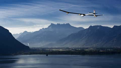 Pilot Andre Borschberg flies the experimental solar-powered aircraft, Solar Impulse, above Lake Geneva during a test flight from Payerne to Geneva on September 21, 2010. (JEAN REVILLARD/AFP/Getty Images)