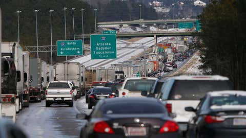 Traffic is at a standstill on Interstate 65 northbound as officials work to clear abandoned vehicles on Jan. 29, 2014 in Pelham, Ala. (AP Photo/Hal Yeager)