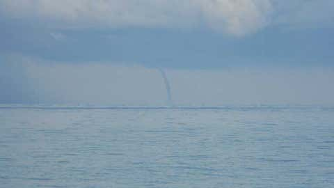 Waterspout 5-10 miles off of Milwaukee, Wisc. near Bradford Beach. (iWitness weather user: Brock Burghardt)