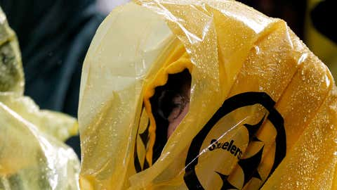 A fan of the Pittsburgh Steelers watches the game wearing a poncho to avoid the rain against the Kansas City Chiefs at Heinz Field on November 12, 2012 in Pittsburgh, Pennsylvania.  (Gregory Shamus/Getty Images)