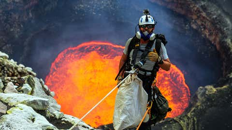 Nik Halik abseils down into Marum, an active lava lake of Ambrym, Vanuatu.