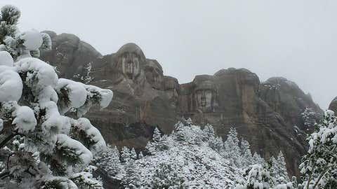 Snow leaves trees sagging at Mt. Rushmore National Memorial on Sept. 11, 2014. (Facebook/Mt. Rushmore National Memorial)
