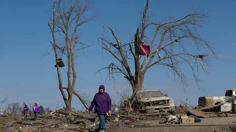 Family and friends of Dave Schabacker assist with cleanup Friday morning, April 10, 2015, after his home was destroyed the night before in Rochelle, Ill. At least two tornadoes swept through Illinois late Thursday.  (AP Photo/Rockford Register Star, Sunny Strader)