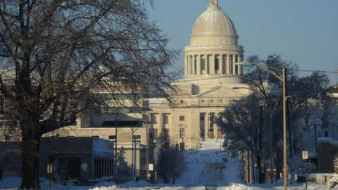 Snow filled roads lead to the Arkansas Capitol building on Wednesday, Dec. 26, 2012 in Little Rock, Ark., after a winter storm brought 10 inches of snow to much of the state. (AP Photo/Kelly P. Kissel)