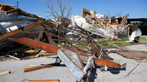 A mobile home frame is pictured between an overturned mobile home at left, and a tornado-damaged mobile home at right, in Sand Springs, Okla., Thursday, March 26, 2015. Gov. Mary Fallin declared a state of emergency for 25 Oklahoma counties that were hit hardest by the storm. (AP Photo/Sue Ogrocki)