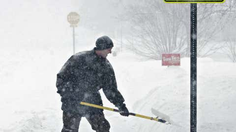 Andy Kilanowski clears his sidewalk of snow along 33rd Street North in St. Cloud, Minn., Sunday, Feb. 10, 2013. Winter Storm Orko dumped snow in the Midwest and Plains just days after Winter Storm Nemo moved through. (AP Photo/The St. Cloud Times, Dave Schwarz)