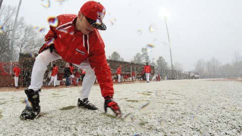 Will Stroupe writes in the snow during a snow delay during Gardner-Webb University's double header baseball game against Dayton University on Saturday, Feb. 16, 2013, in Boiling Springs, N.C. (AP Photo/The Star, Ben Earp)