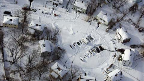 A neighborhood near New Haven, Conn., is buried in snow in the aftermath of a storm that hit Connecticut and much of New England. (AP Photo/Craig Ruttle)